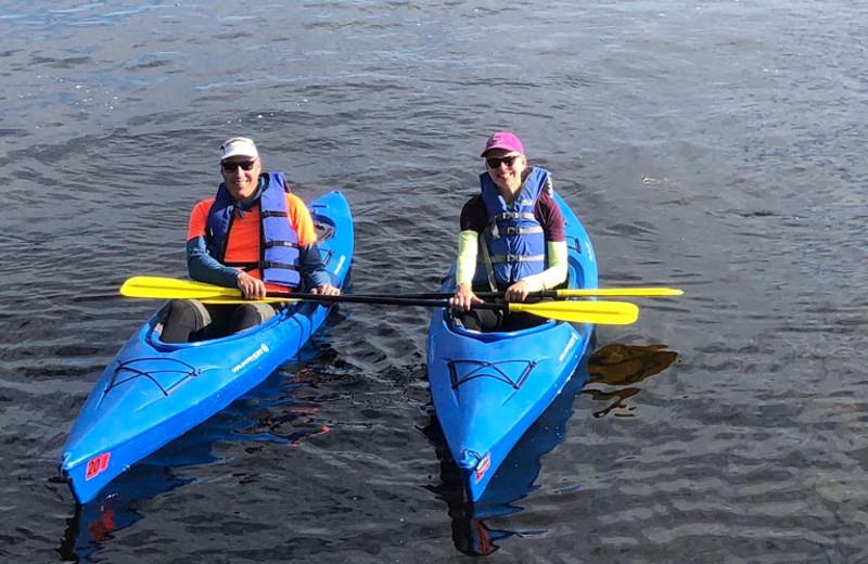 Couple kayaking the lake together.
