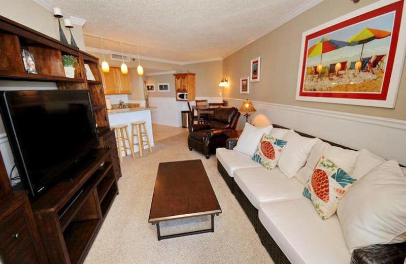 Rental living room and kitchen at MyrtleBeachVacationRentals.com.
