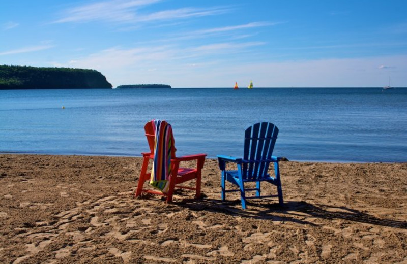 Chairs on the beach at Bay Breeze Resort.