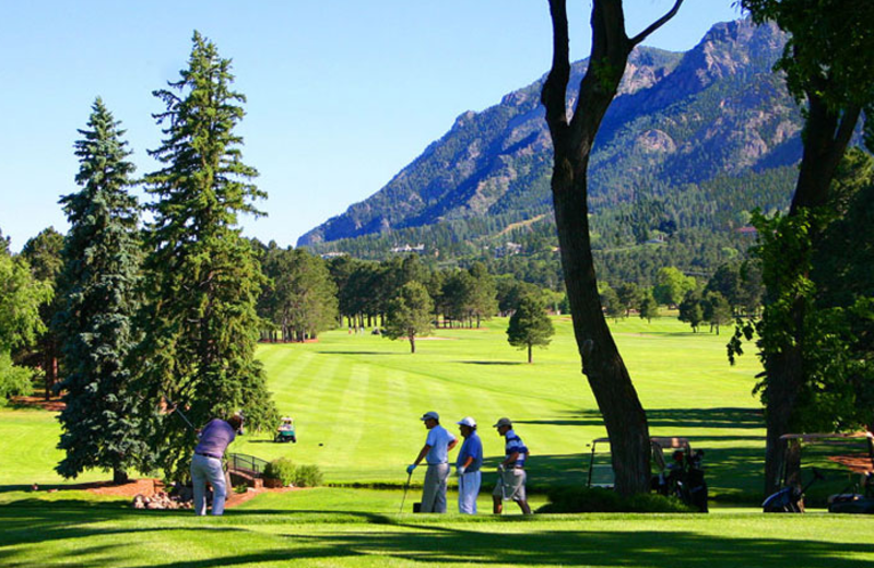 Playing golf at The Broadmoor.