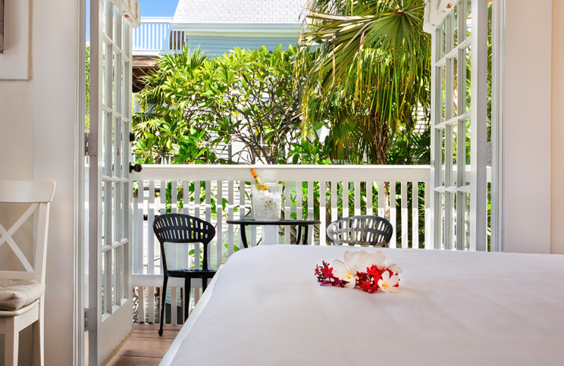 Guest bedroom with balcony at Southernmost Inn.