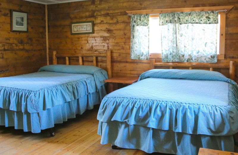 Cabin beds at Trappers Lake Lodge & Resort