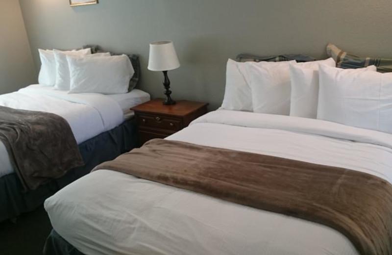 Cabin bedroom at Long Barn Lodge.