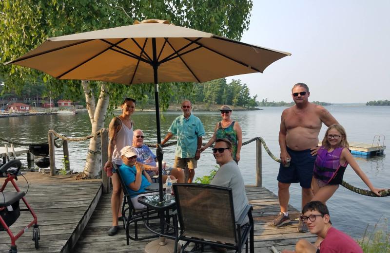 Family on dock at Grandview of Lake Kabetogama.