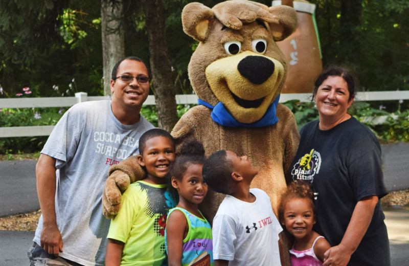 Family with Boo Boo at Yogi Bear's Camp Golden Valley.