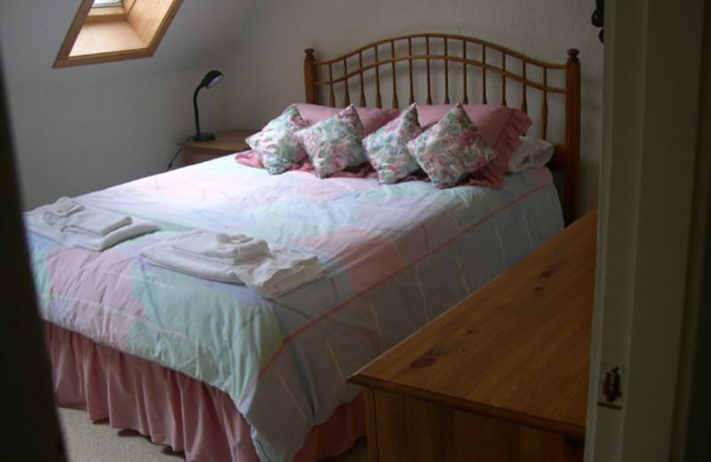 Vacation rental bed room at Village Condominium.