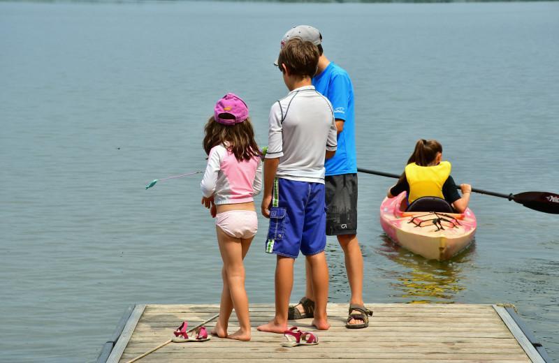 Fishing at Sandbanks Summer Village Cottage Resort.