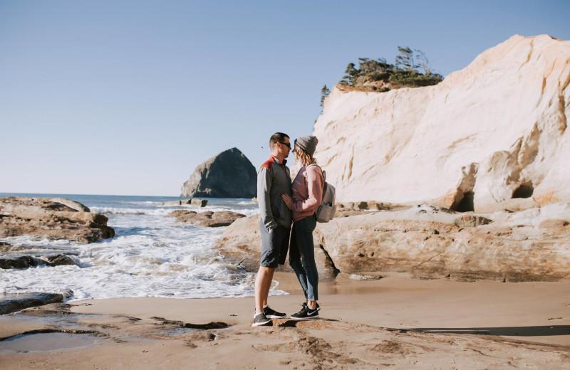 Couple on beach at Inn at Cape Kiwanda.