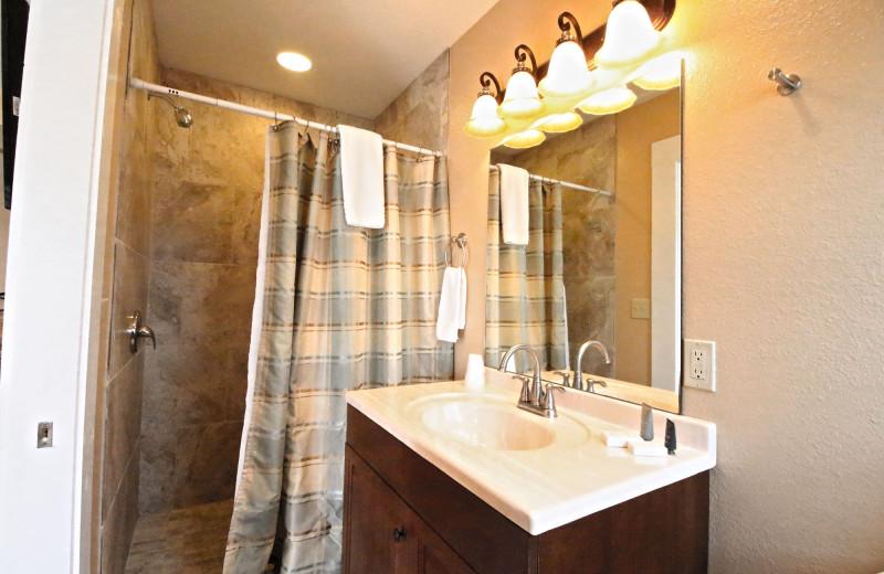 Guest bathroom at Peach Tree Inn & Suites.