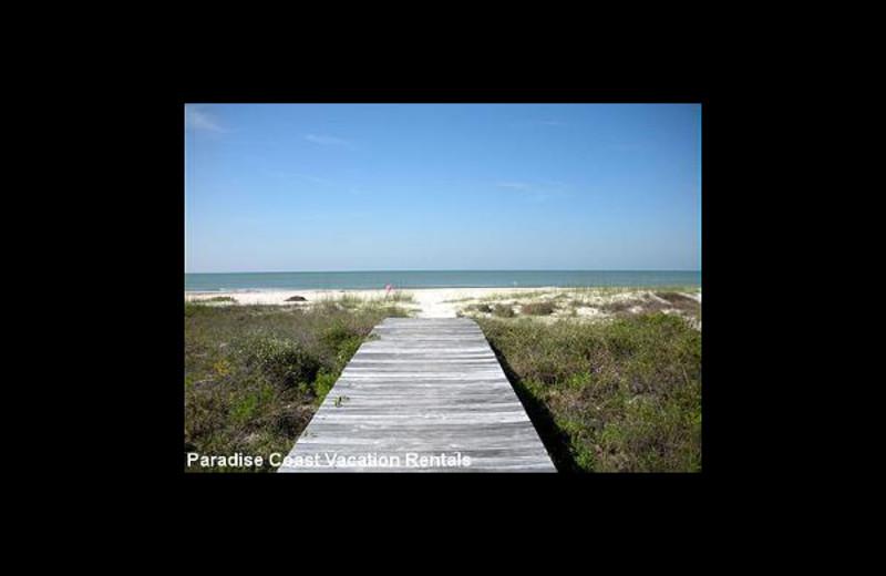 The beach at Paradise Vacation Rentals.