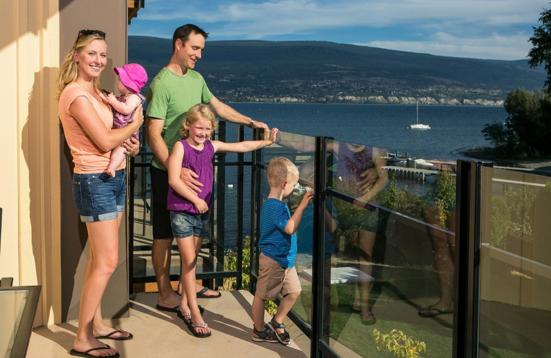 Family on balcony at Summerland Waterfront Resort.