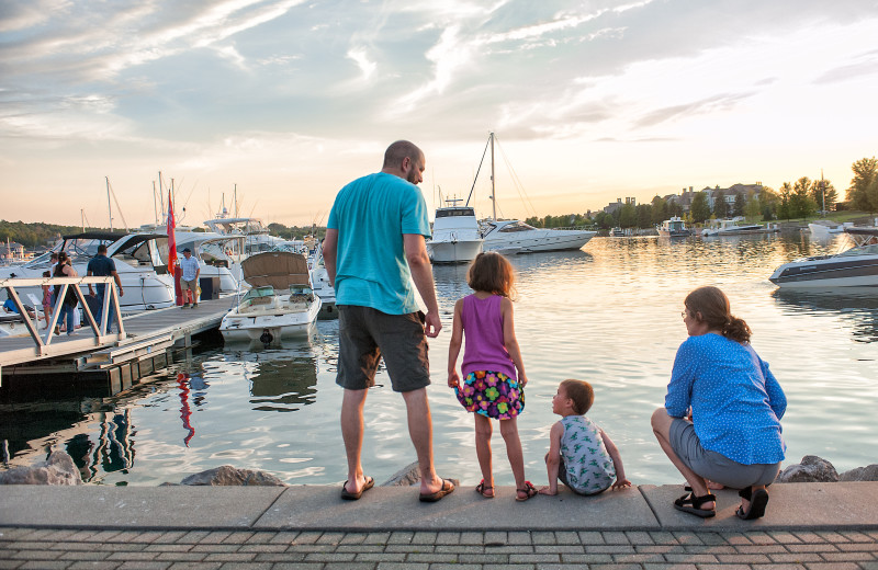 Family on dock at Bay Harbor Village Hotel & Conference Center.