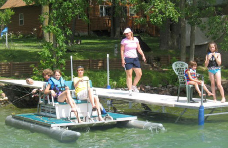 Family On Lake Dock at Janetski's Big Chetac Resort