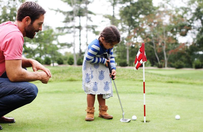 Family golf at Foscoe Rentals.