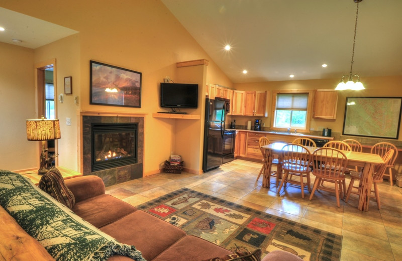 This is the living room and kitchen inside our 3 bedroom deluxe cabin. It's our newest cabin and located only 1/2 mile from Glacier National Park