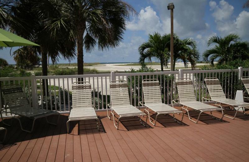 Poolside sun chairs at Sunsational Beach Rentals. LLC.