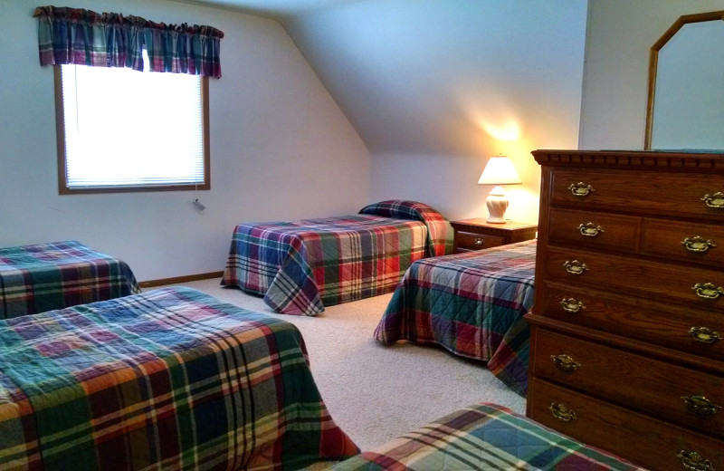 Cabin bedroom at The Arrows.