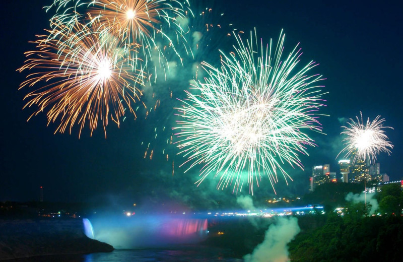 Fireworks over waterfall at DoubleTree Fallsview Resort & Spa by Hilton - Niagara Falls.