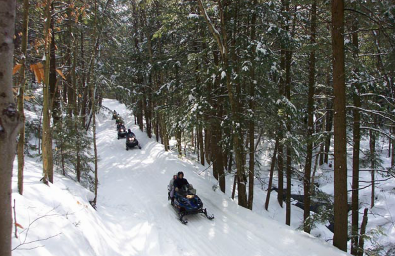 Snowmobiling at Ridin-Hy Ranch Resort.