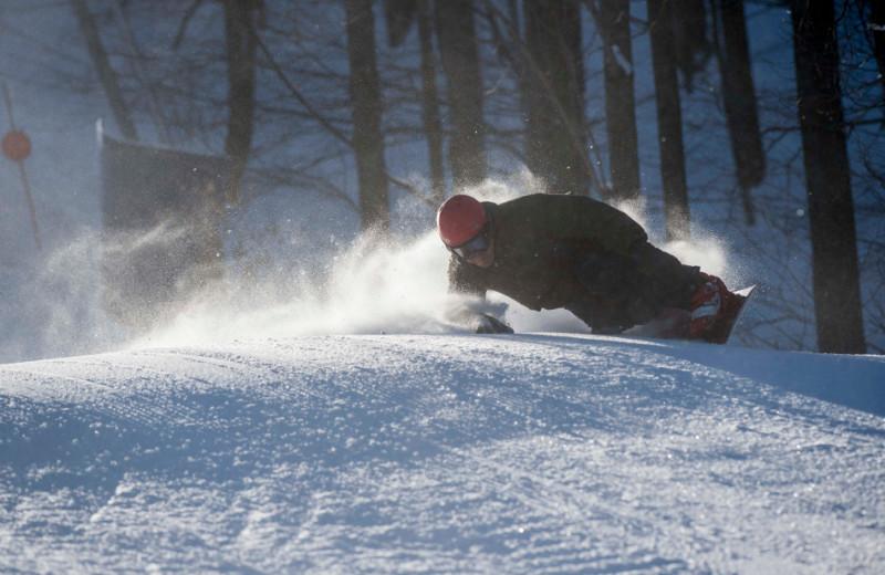 Snowboarding at Holiday Valley Resort.