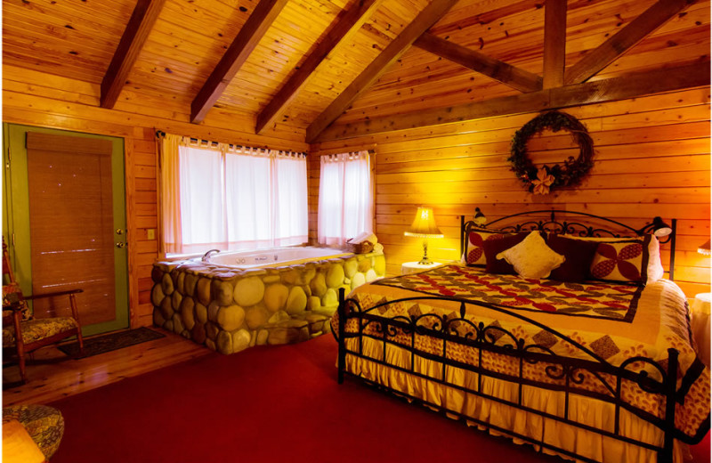 Cabin bedroom at Whispering Hills Cabins.