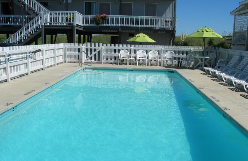Outdoor pool at Beach House Inn and Suites.