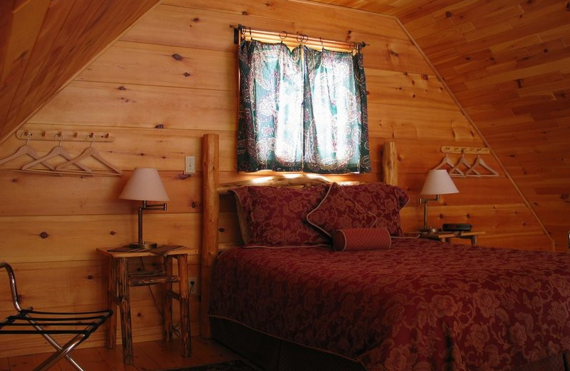 Cabin bedroom at Windermere Creek Bed & Breakfast Cabins.