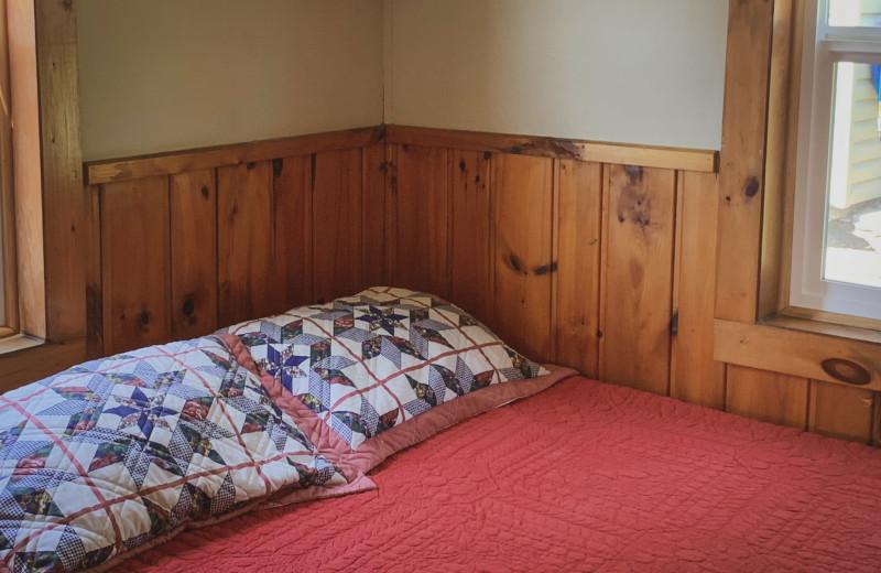 Cottage bedroom at Holly's Resort.