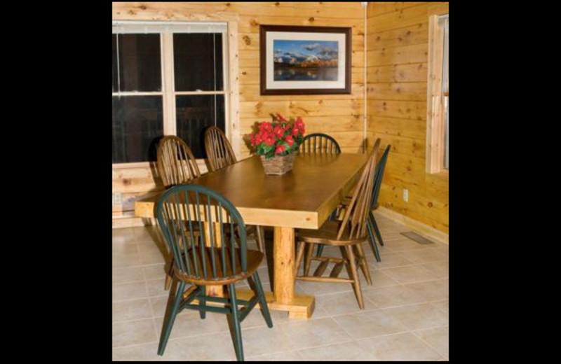Cabin dining room at Hummingbird Hill Cabin Rentals.