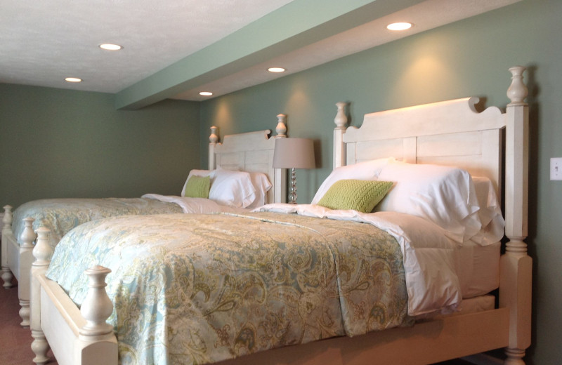 Guest beds at Bay Pointe Inn.