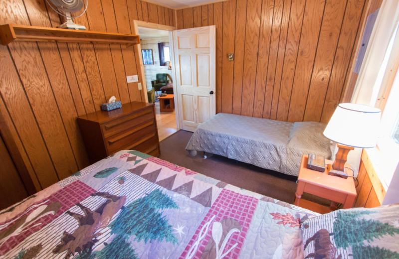 Cabin bedroom at Krueger's Harmony Beach Resort.