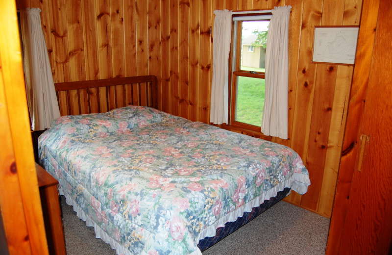 Cottage bedroom at Fisher's Lakeside Cottages.