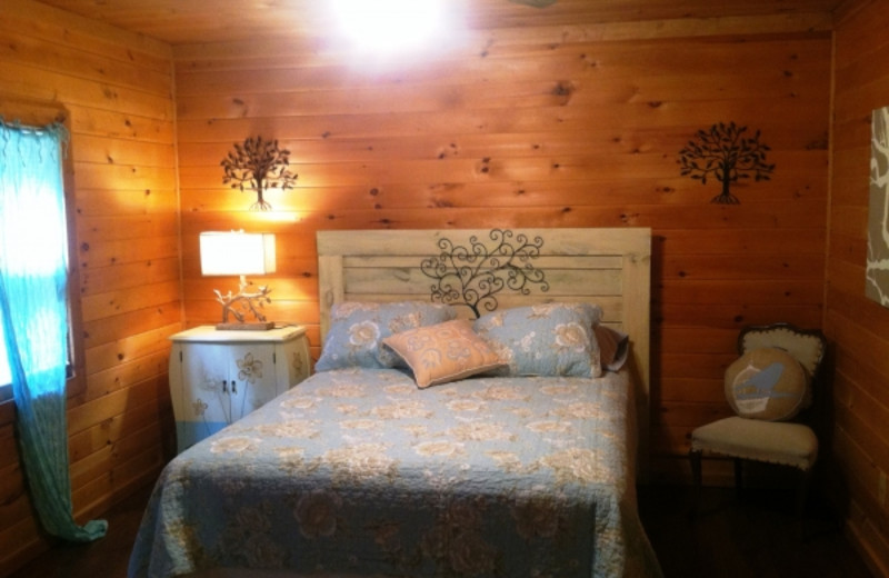 Cabin bedroom at Cabins in Hocking.