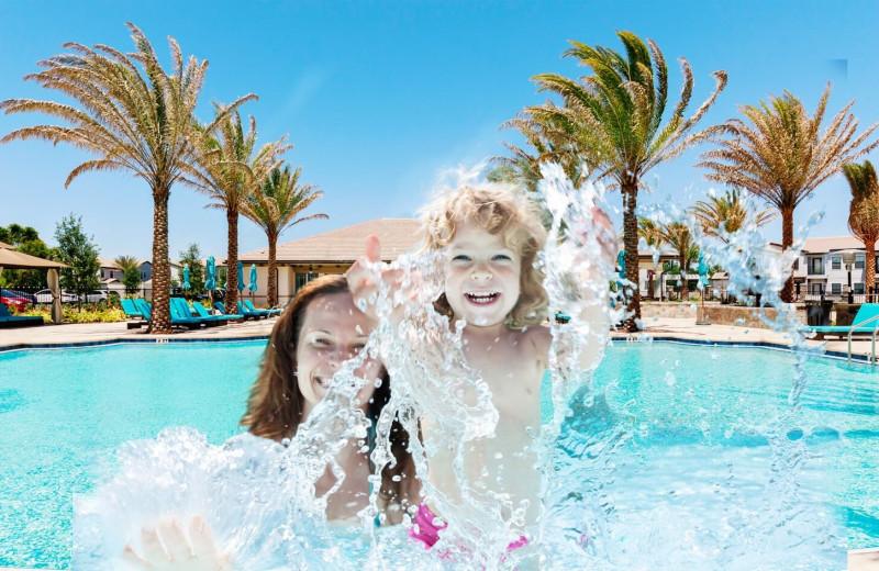 Family splashing in pool at Balmoral Resort.