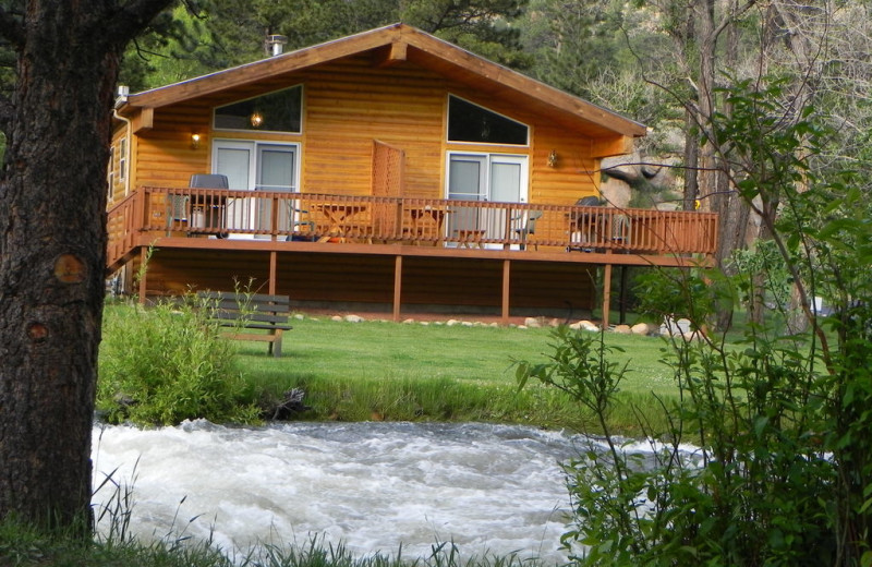 Cabin by the river at Riverview Pines.
