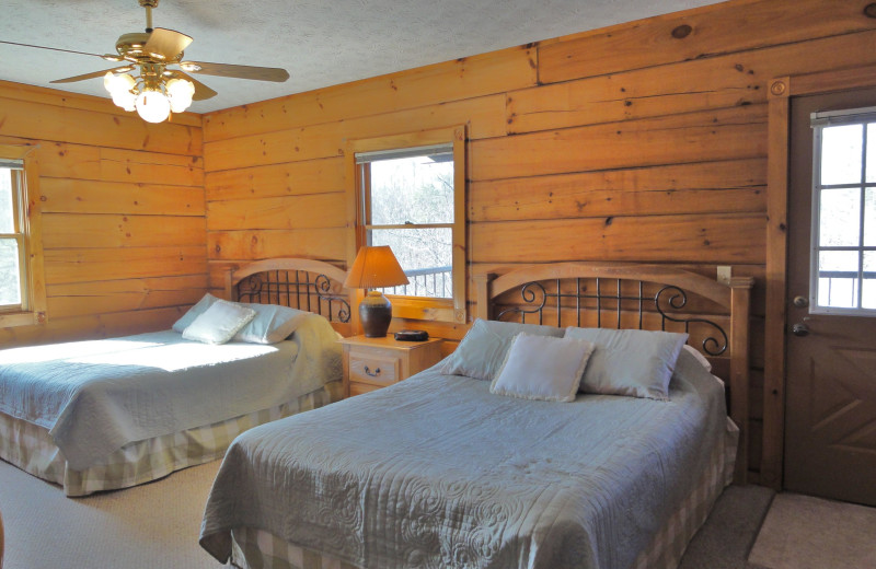 Rental bedroom at Country Pines Log Homes.