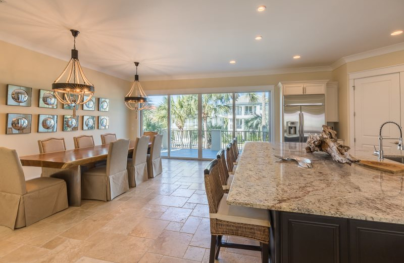 Rental kitchen and dining room at Luxury Properties Vacation Rentals.