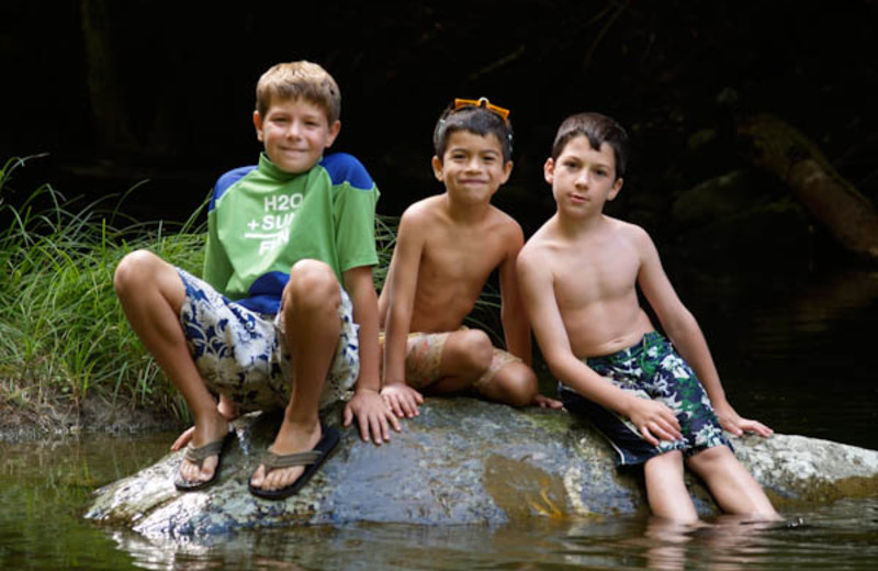 Kids cool off in the creek at Common Grounds Center.