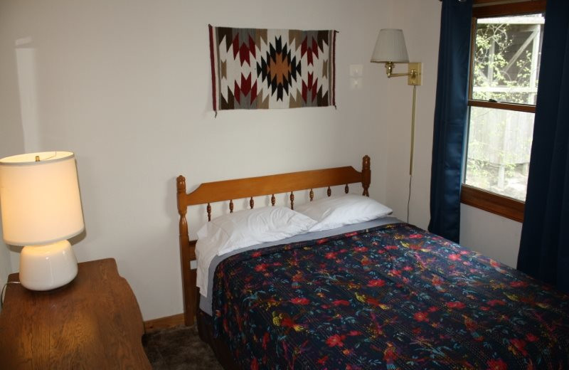 Cabin bedroom at Arkansas White River Cabins.