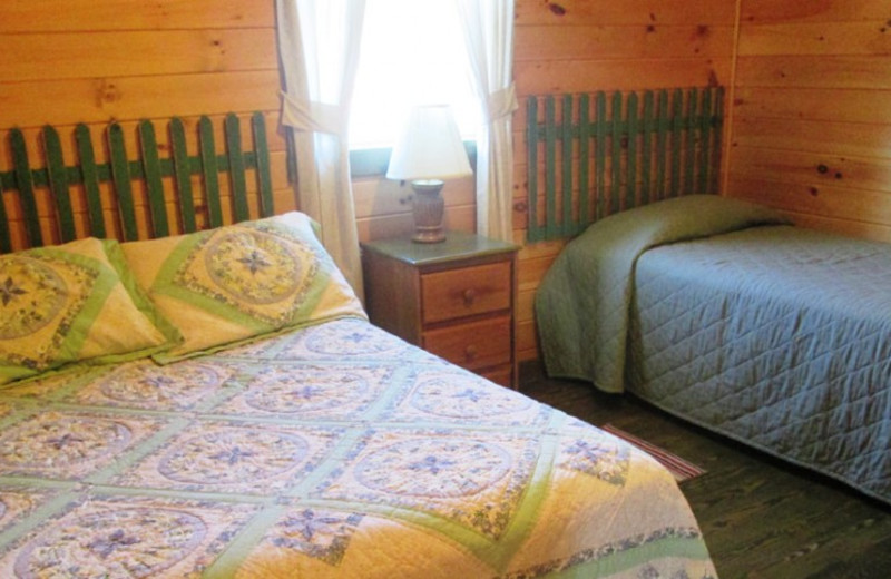 Cabin bedroom at Jackson's Lodge and Log Cabins.