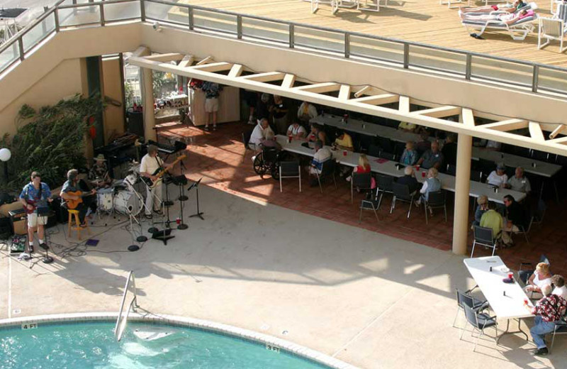 Live poolside music at The Dunes Condominiums.
