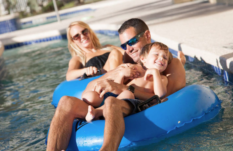 Family in pool at Best Western Ocean Sands Resort.