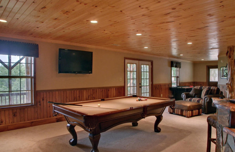 Billiards table at Southern Comfort Cabin Rentals.