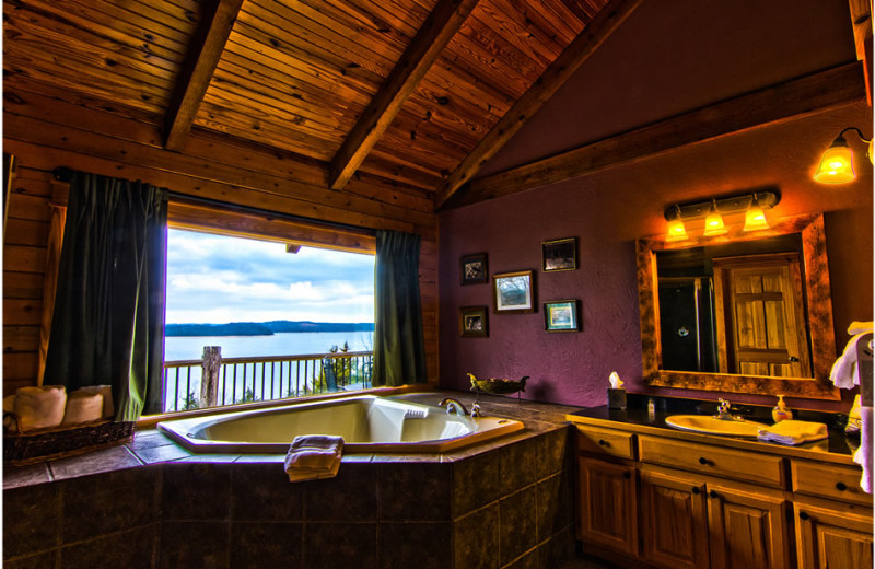 Cabin hot tub at Whispering Hills Cabins.