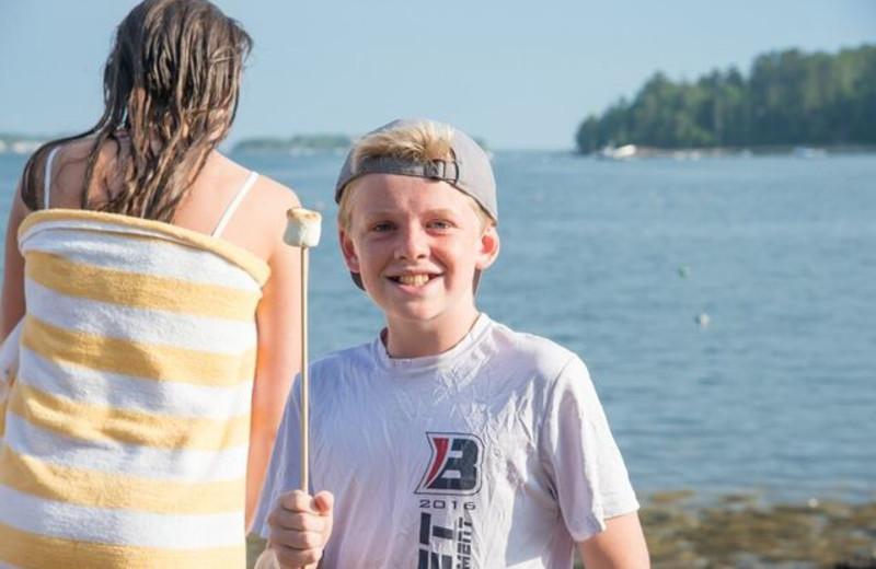 Kid with marshmallow at Linekin Bay Resort.