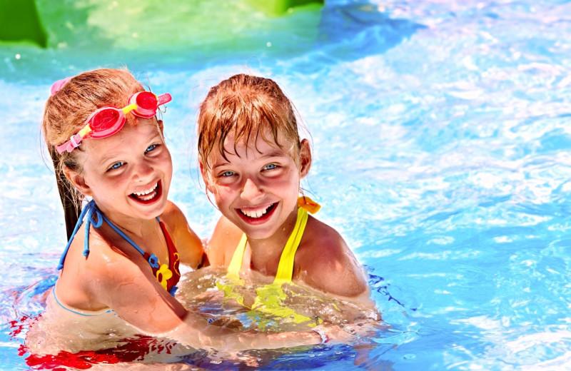 Kids swimming at RiverStone Resort & Spa.