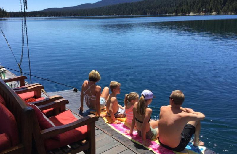 Family on floating dock at Elk Lake Resort.