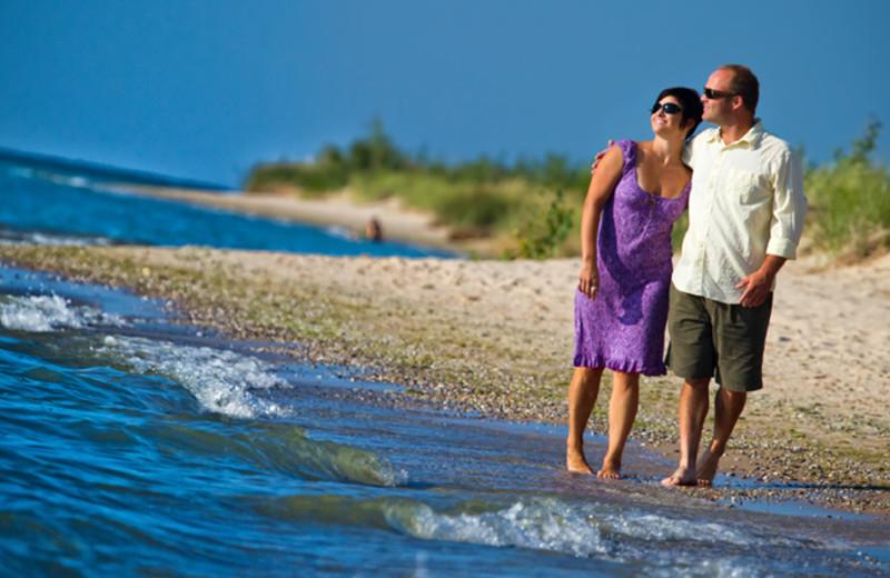 Couple on beach at The Homestead.