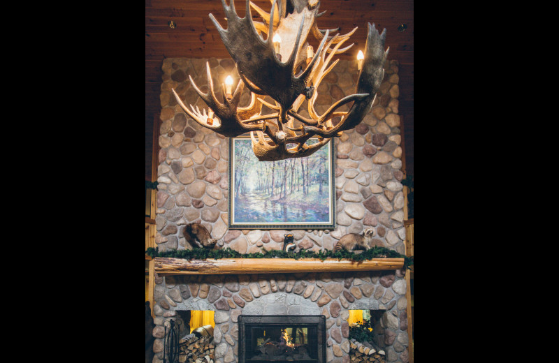 Antler chandelier and fireplace at Superior Shores Resort.