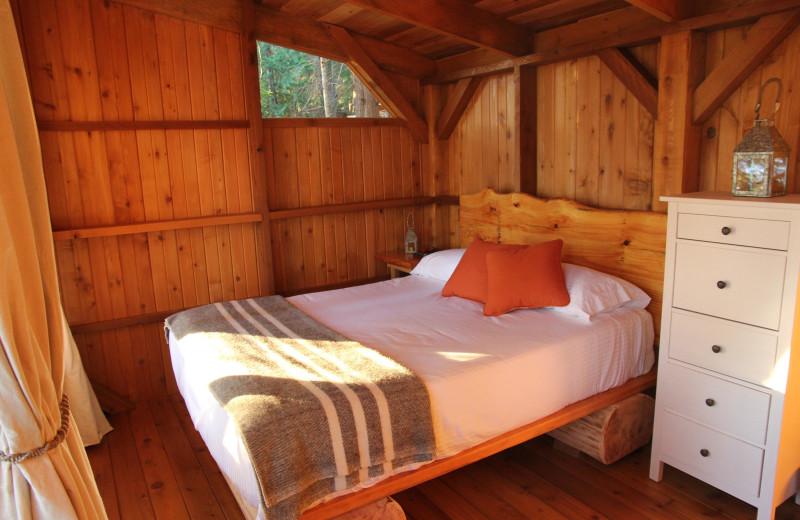 Guest bed at Cabana Desolation Eco Resort.